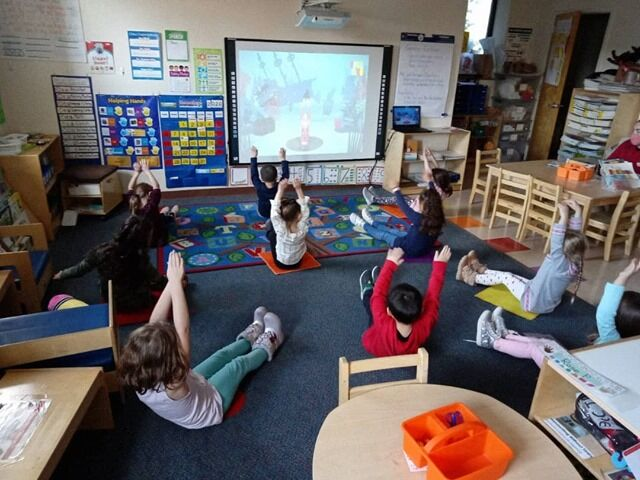 Our Kindergartens are taking a brain break by doing yoga!
